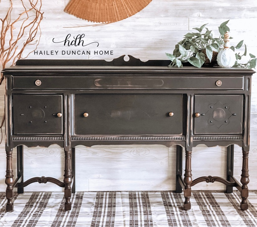Painted vintage black buffet with stained legs.