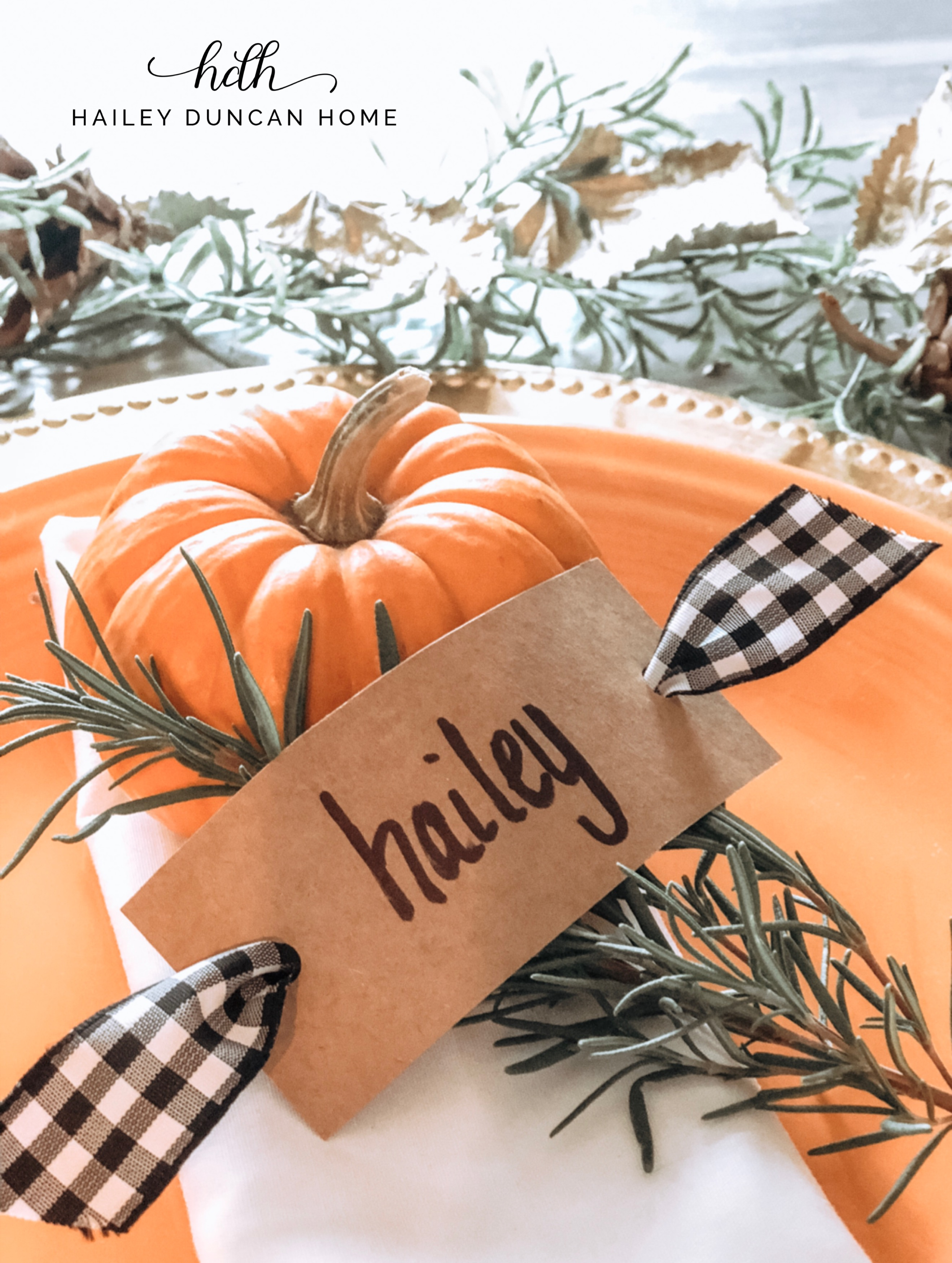Thanksgiving place setting with pumpkin and name card