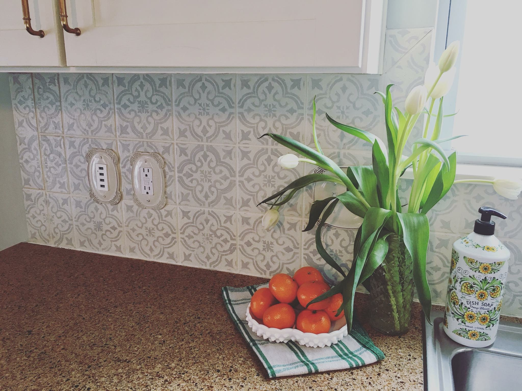 How to Paint and Stencil Your Tile Backsplash. This is a budget friendly kitchen update!