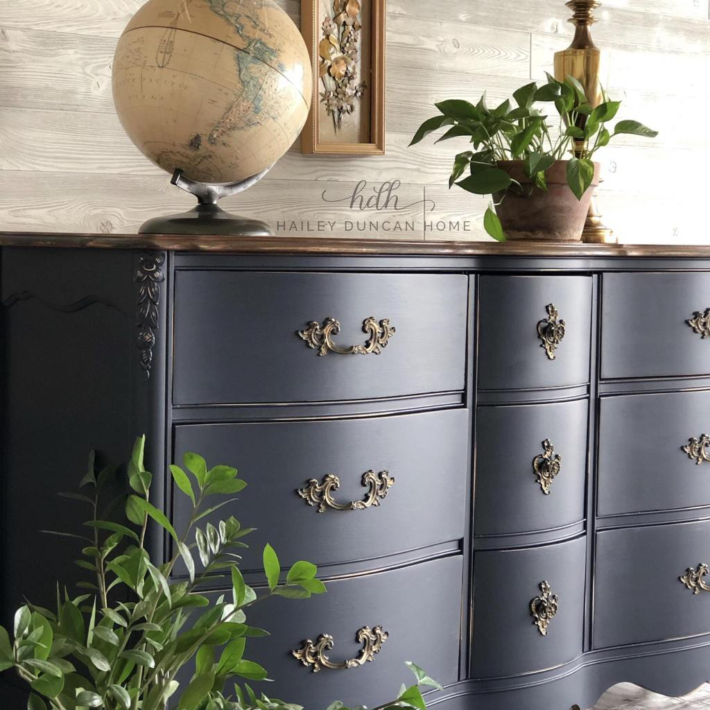 Dresser Makeover in Coastal Blue paint by General Finishes with a stained top and the original hardware.