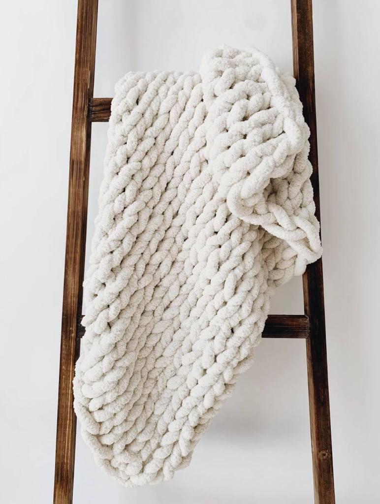 Chunky white blanket on blanket ladder