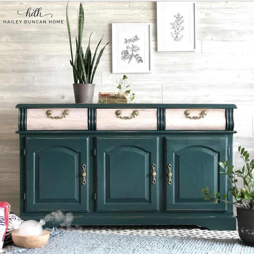 Dark green buffet with drawers left a natural wood color and gold hardware.