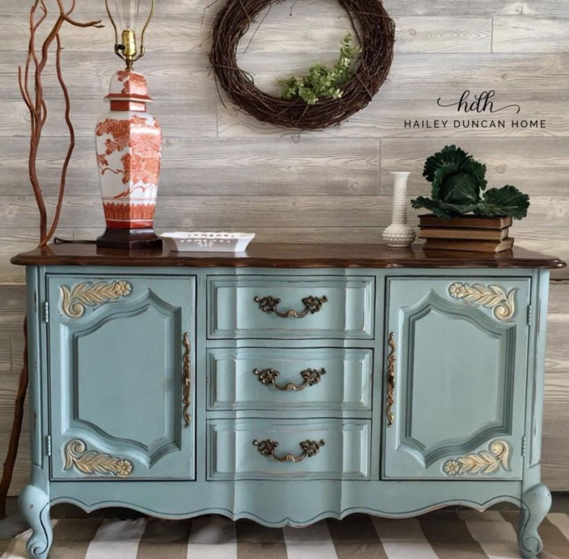 Light teal painted buffet with a stained top.